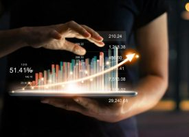 businessman-holding-tablet-showing-growing-virtual-hologram-statistics-graph-chart-with-arrow-up (2) (1)